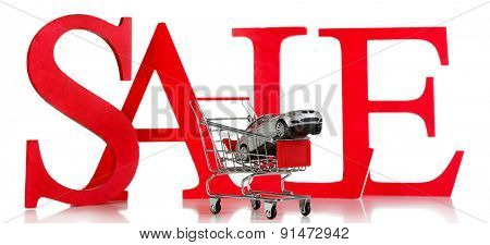 Letters Sale with toy car isolated on white