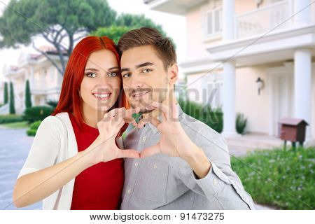 Loving couple near their house