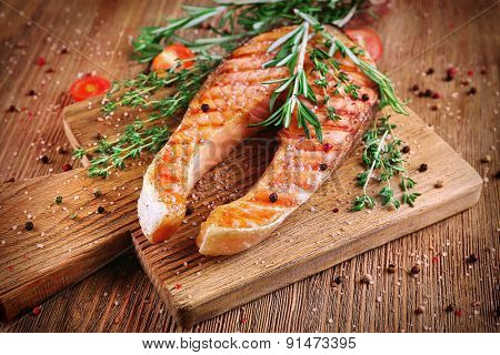 Grilled salmon on cutting board close-up