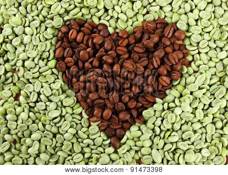 Green and brown coffee beans in shape of heart, close up