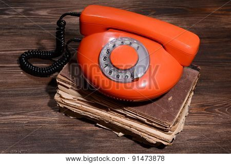 Retro red telephone on table close-up