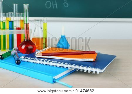 Desk in chemistry class with test tubes close up
