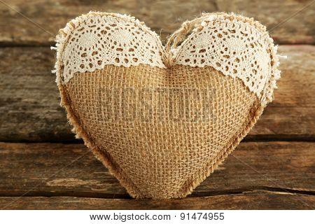 Vintage heart on wooden background