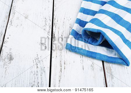 Checkered napkin on wooden table background
