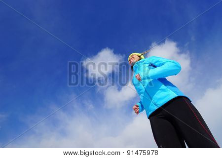 Young woman making exercises on a snow field
