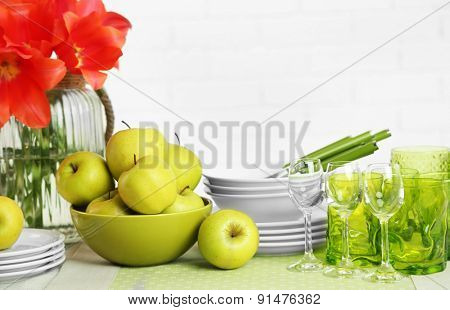 Colorful table settings and tulip flowers in vase on table, on light background