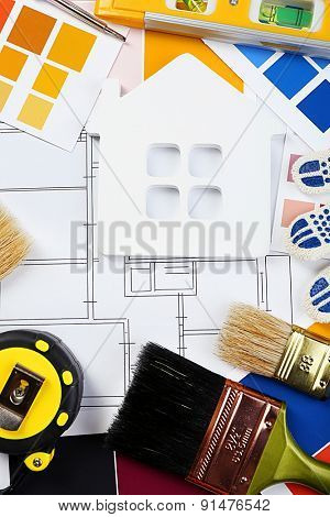Construction instruments, plan and brushes close-up