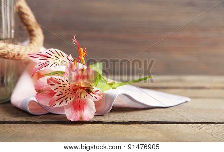 Bouquet of alstroemeria on wooden background