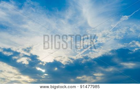 White Fluffy Clouds In The Blue Sky With Sun Light