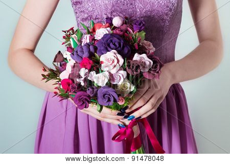 bouquet for the bride, girl in purple evening dress holding a large bouquet of multicolored roses in