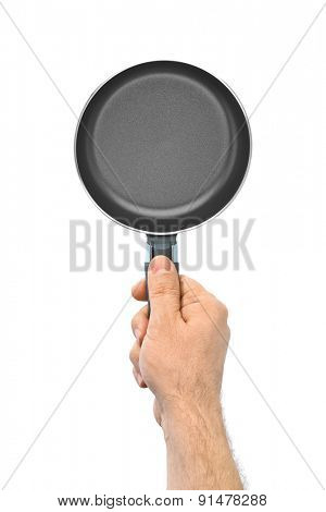 Hand with frying pan isolated on white background