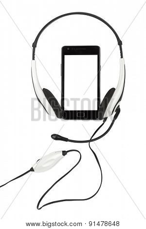 Mobile phone and headphones isolated on white background