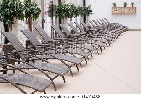 The image of chaise-longues in a spa