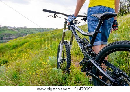 Cyclist and his Bike on the Beautiful Spring Mountain Trail