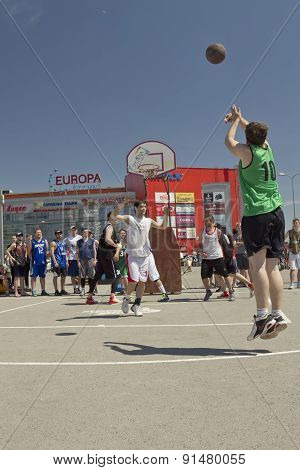 Unidentified Young People Play In Streetball