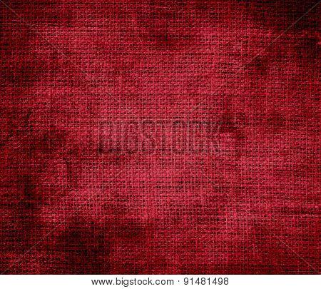 Grunge background of carmine burlap texture