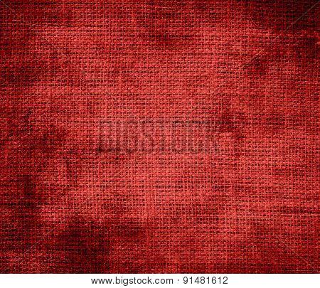 Grunge background of carnelian burlap texture