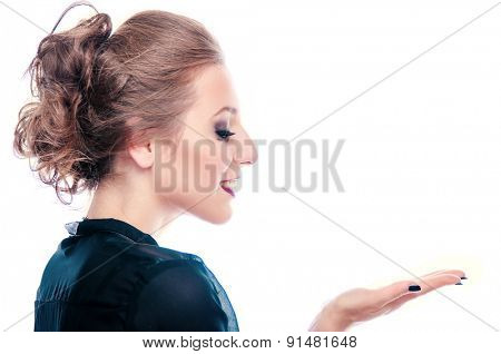 Happy young business woman presenting something on her palm, isolated on white