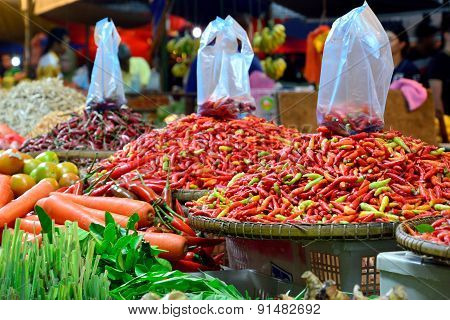 Vegetable Stall Selling Red Chilies, Carrots, Tomatoes And Other Type Of Vegetables