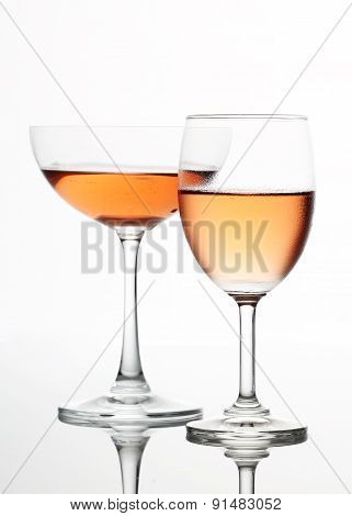 The sparking rose wine in the wine glass couple set