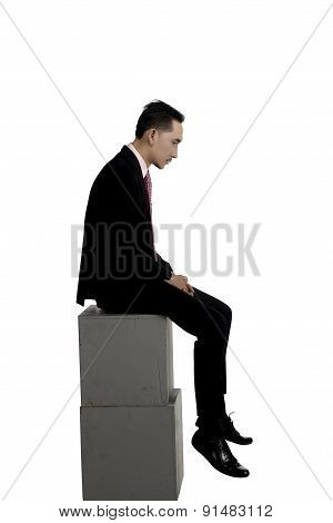 Asian Business Man Feeling Sad Sitting On The Box