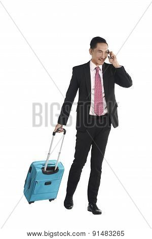 Business Man Walking With Suitcase And Talking Via Cellphone