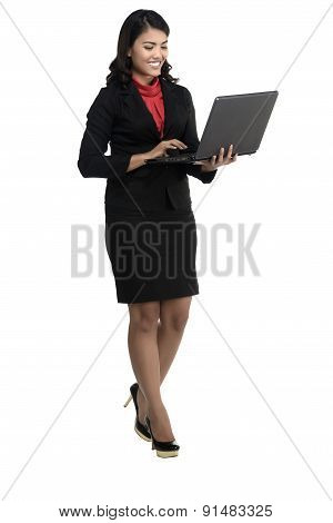 Asian Business Woman Using Laptop While Standing