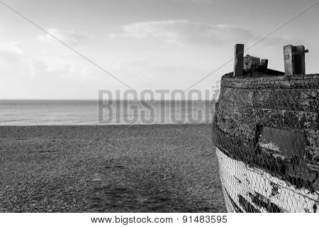 Old Abandoned Fishing Boat On Beach In Monochrome Tones