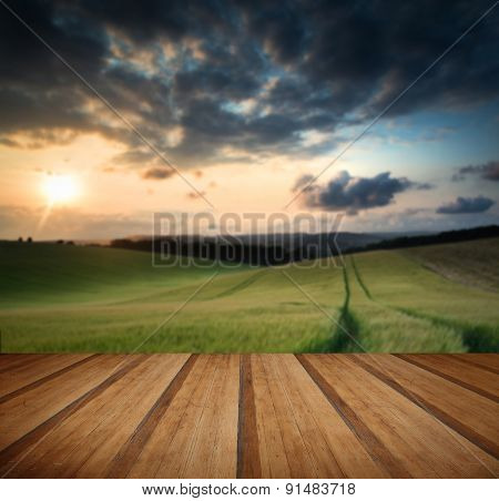 Sunset Over Countryside Landscape With Wooden Planks Floor