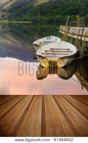 Rowing Boats Moored At Jetty On Llyn Nantlle In Snowdonia National Park With Wooden Planks Floor