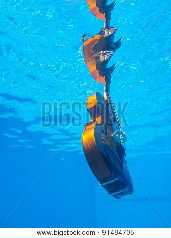 Violin underwater in the swimming pool