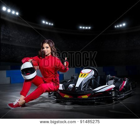 Young girl karting racer at stadium