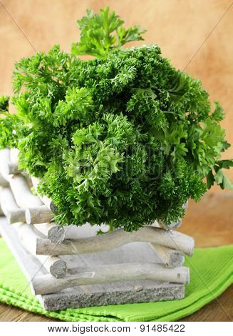 bunch of fresh green organic parsley on a wooden table