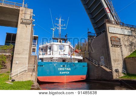 Big Cargo Ship Comes To The Narrow Gateway Of Lock