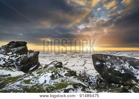 Stunning Winter Sunset Landscape From Mountains Looking Over Snow Covered Countryside