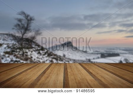 Beautiful Winter Landscape At Vibrant Sunset Over Snow Covered Countryside With Wooden Planks Floor