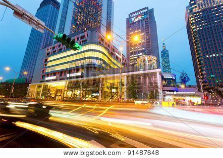 traffic light trails in modern street