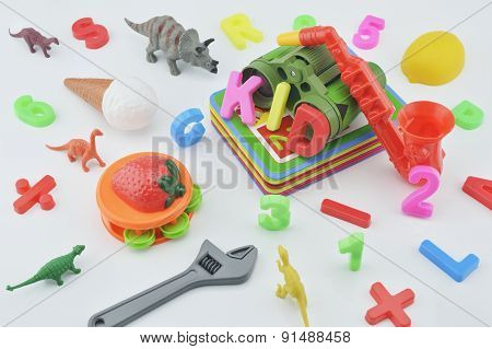 Colorful Plastic Toys On White Background, Kid Education Concept