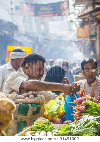 Man Sells Bananas At The Old Vegetable Street Market In Delhi