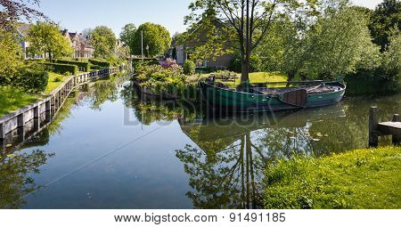 Old Barge In The Canal Of A Village