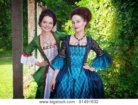 Two Young Beautiful Women In Medieval Dresses Outdoor