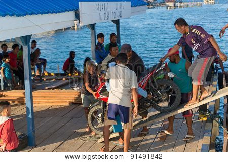 People Disembarking Scooter From Ferry Boat