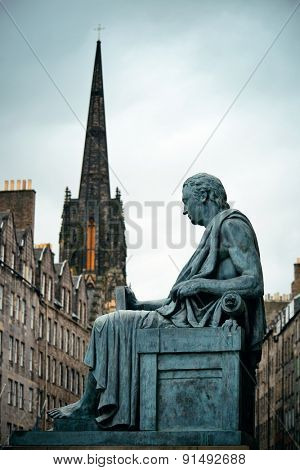 Statue and Edinburgh city view in United Kingdom.