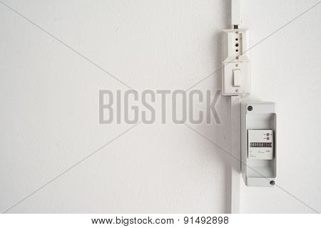 Electricity Meter In A White Wall