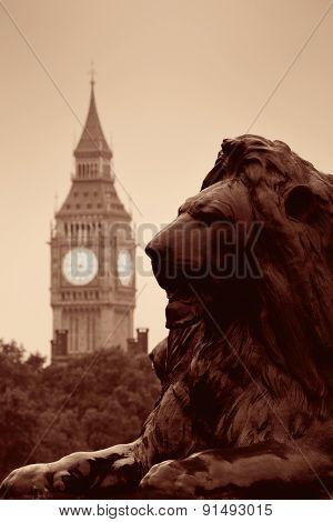 Trafalgar Square lion statue and Big Ben in London