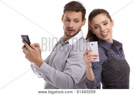 couple and secret message on cell phone. the concept of betrayal