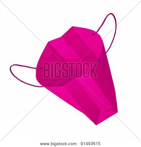 Empty Pink Gift Bag Falls Through The Air On An Isolated White Background