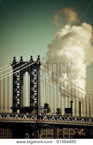 Manhattan Bridge with chimney smoke in New York City