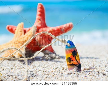 Necklace And Starfish Stuck In The Sand