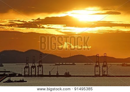 Silhouette Of Port Warehouse And Crane Bridge